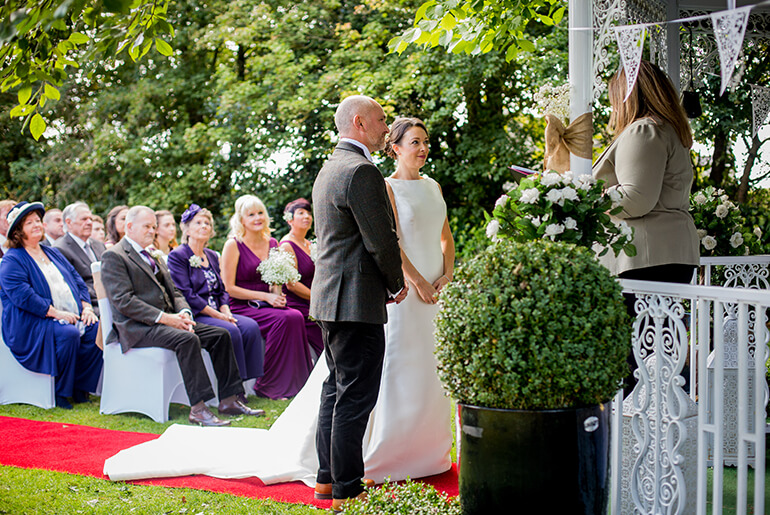 Bride and Groom using the Stunning Horton Grange Gazebo for their Wedding Ceremony